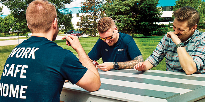 Inpro Employees sitting on a picnic table
