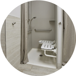 A shower stall with a shower seat