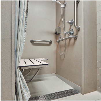 A shower stall with a seat and pulled aside curtain