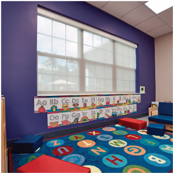 A school room with purple walls with a large window