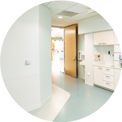 Medical center hallway with white G2 Bioblend wall sheet protection