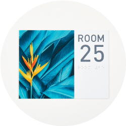 Sign that reads Room 25 with a vibrant floral image next to it
