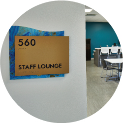 Sign stating staff lounge next to a room with tables