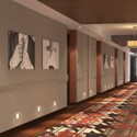 Hotel corridor with people printed wall art