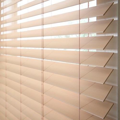 Close up of commercial use faux wood horizontal blinds