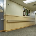 Rigid vinyl beadboard in light wood grain finish in corridor