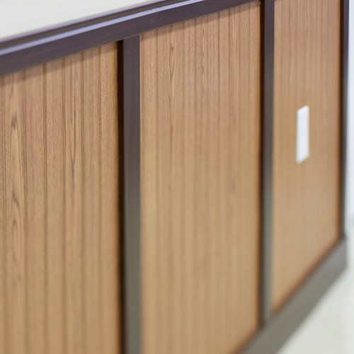 Close up image of light wood grain rigid vinyl