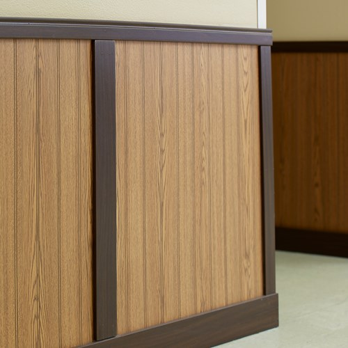 Light wood grain finish rigid vinyl beadboard with dark wood finish trim