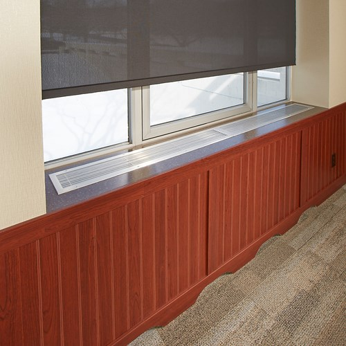 Rigid vinyl beadboard in wood grain finish in conference room
