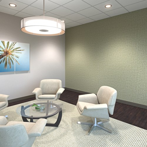 Ricochet® Spark Flexible Wall Protection in Sage Green on a wall in a waiting room