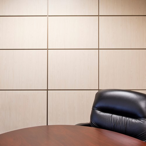 Wall Panel System with wrapped panels in a conference room